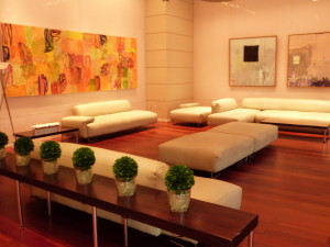 Sophisticated Condo/Hotel Lobby adorned with art & various conversations areas